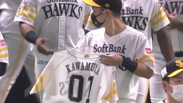 晃と川村隆史コーチのユニフォーム